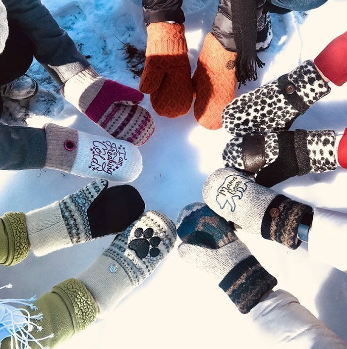 Circle of hands wearing Sully's Sofites Mittens