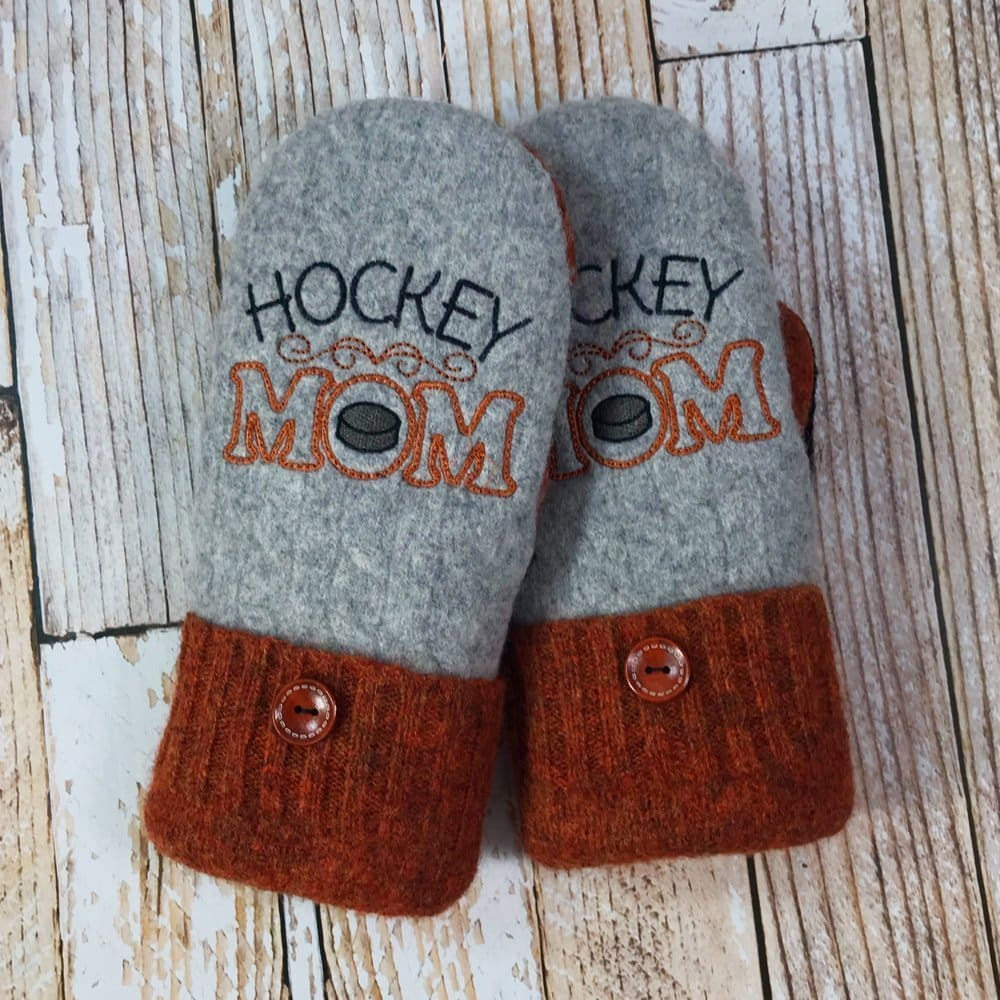 "gray and burnt orange mittens with ""Hockey Mom"" embroidery"